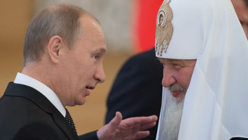 Президент России Владимир Путин (слева) и Патриарх Московский и всея Руси Кирилл