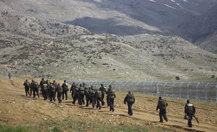 Израильские полицейские на границе с Сирией у города Мадждаль-Шамс