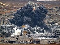 Дым над Кобани после авиаудара, нанесенного силами коалиции во главе с США