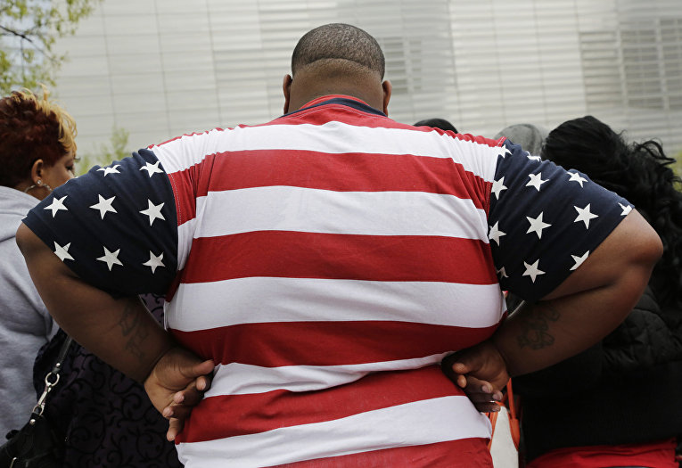 Мужчина с лишним весом в Нью-Йорке