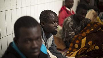 Мигранты из Ганы, Чада и Нигерии, которые пытались попасть в Европу, задержаны в Триполи, Ливия