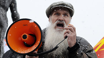 Участник шествия «Русский марш» в Красноярске