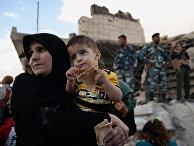 Раздача российской гуманитарной помощи населению Сирии
