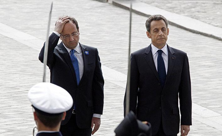 Уходящий президент Франции Николя Саркози и недавно избранный президент Франсуа Олланд