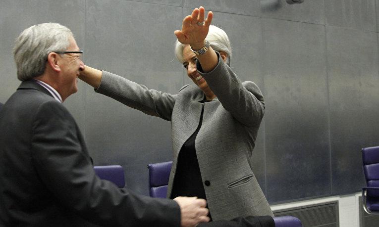 Председатель Европейской комиссии Жан-Клод Юнкер и директор-распорядитель Международного валютного фонда Кристин Лагард