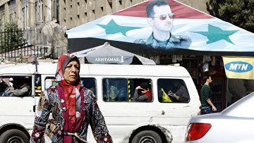Портрет президента Сирии Башара Асада в центре Дамаска. 7 апреля 2017