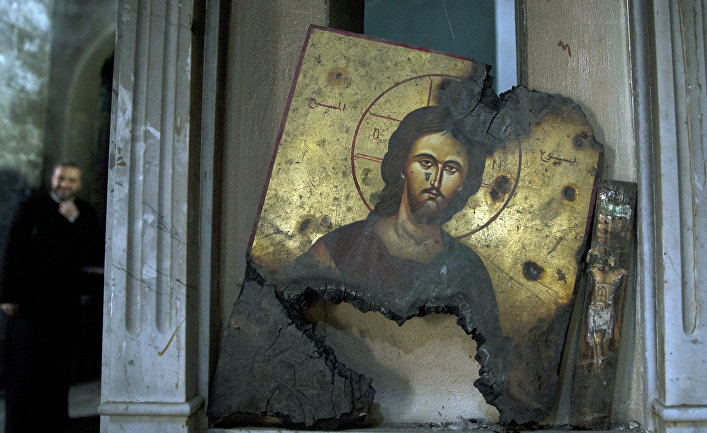 Полусоженная икона в греческой Православной Церкви в Сирии