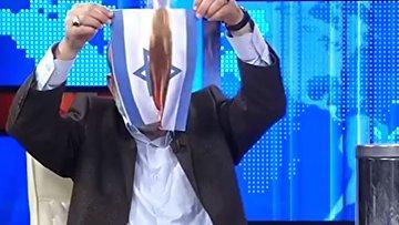Турецкий телеведущий сжигает флаг Израиля