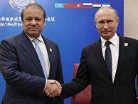 Президент РФ Владимир Путин и премьер-министр Пакистана Наваз Шариф на саммите ШОС в Астане. 9 июня 2017