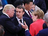 Президент США Дональд Трамп, президент Франции Эммануэль Макрон и федеральный канцлер Германии Ангела Меркель на саммите G20 в Гамбурге