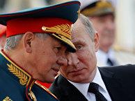 Президент РФ, верховный главнокомандующий Владимир Путин и министр обороны РФ Сергей Шойгу