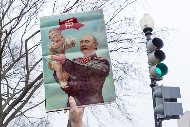 Плакат во время женского марша в Вашингтоне