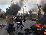 Участники акции протеста в Палестине против решения о признании Иерусалима столицей Израиля. 7 декаабря 2017