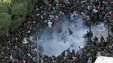 Столкновение во время акции протеста в Тунисе 14 января 2011 года