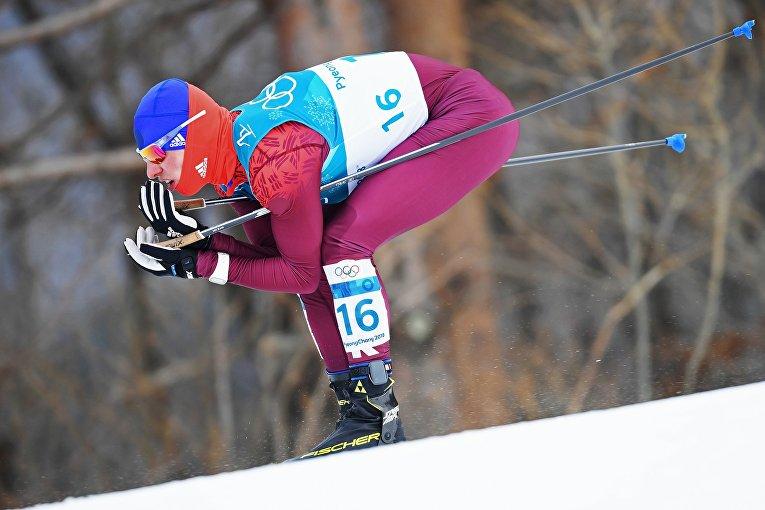Российский спортсмен Денис Спицов на дистанции скиатлона среди мужчин в соревнованиях по лыжным гонкам на XXIII зимних Олимпийских играх в Пхенчхане. 11 февраля 2018