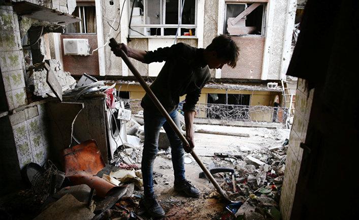 Поврежденный дом в Восточной Гуте