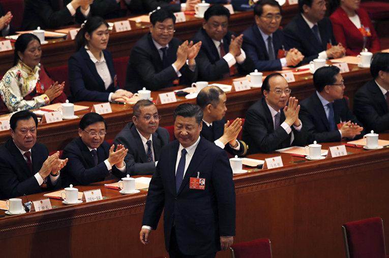 Председатель КНР Си Цзиньпин после голосования во время Всекитайского собрания народных представителей. 11 марта 2018