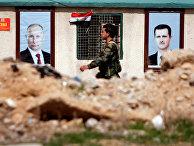 Портреты президента РФ Владимира Путина и президента Сирии Башара Асада на улице в Восточной Гуте