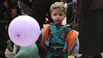 Сирийский маличик, эвакуированный из восточной Гуты