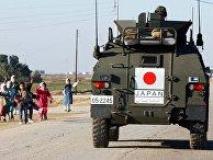 Солдаты японской армии покидают военную базу в Самаве, Ирак