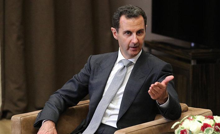 Президент Сирии Башар Асад во время встречи с президентом РФ Владимиром Путиным