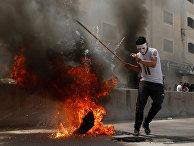 Палестинские демонстранты во время протеста против переезда посольства США в Иерусалим