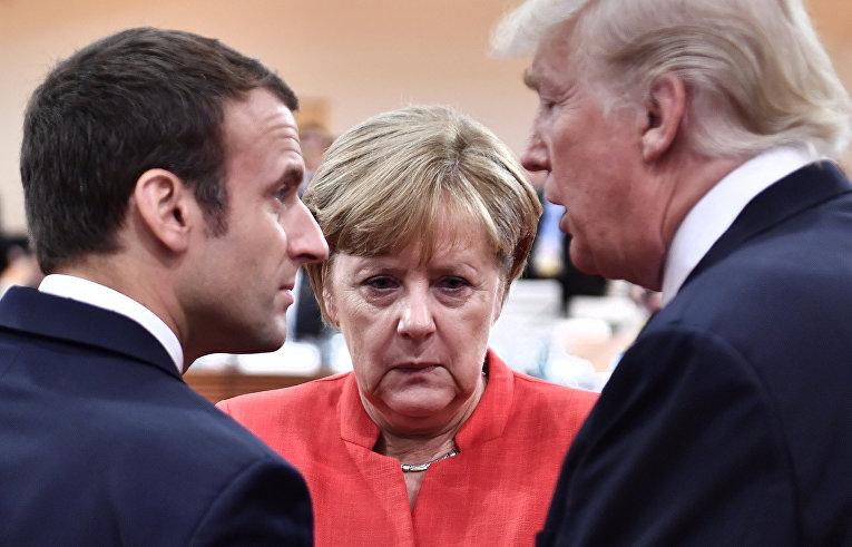 Президент Франции Эммануэль Макрон, канцлер Германии Ангела Меркель и президент США Дональд Трамп