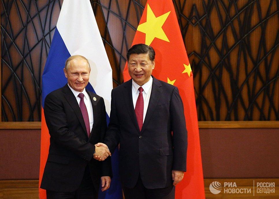 Президент РФ Владимир Путин и председатель КНР Си Цзиньпин