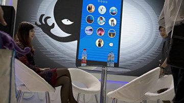 Участники глобальной конференции мобильного интернета в Пекине