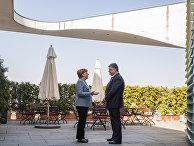 Президент Украины Петр Порошенко и канцлер Германии Ангела Меркель во время встречи в Берлине. 10 апреля 2018