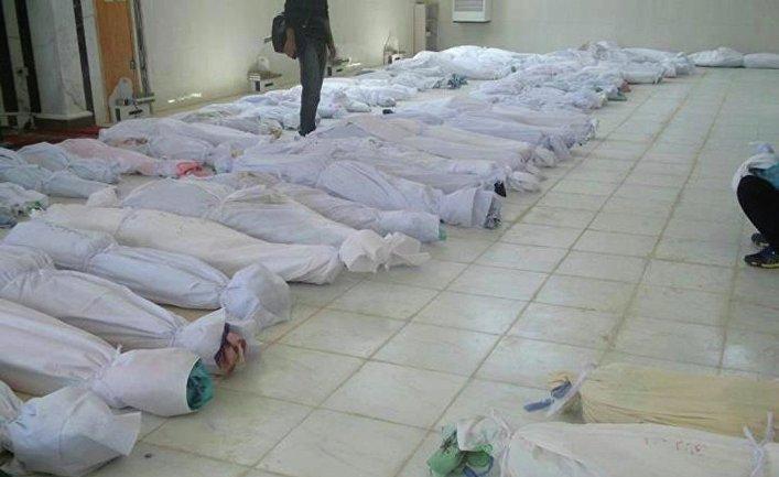 Тела погибших при артобстреле города Хула в Сирии