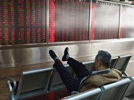 Экран с ценами на акции и ценные бумаги в Пекине