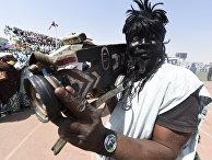 Житель Нигерии с камерой