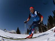 Максим Вылегжанин (Россия) на дистанции эстафеты в соревнованиях по лыжным гонкам среди мужчин на XXII зимних Олимпийских играх в Сочи