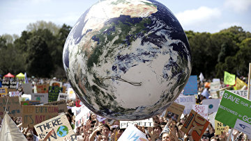 Участники акции протеста призывают к действиям по защите от изменения климата в Сиднее