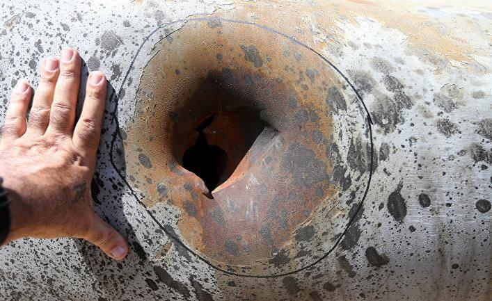 Поврежденный после атаки дронов нефтяной объект в Хурайсе, Саудовская Аравия