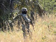 Вооруженный солдат в Мозамбик