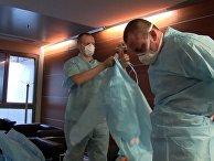 Подготовка врачей из РФ и Италии к приему пациентов в полевом госпитале в Бергамо