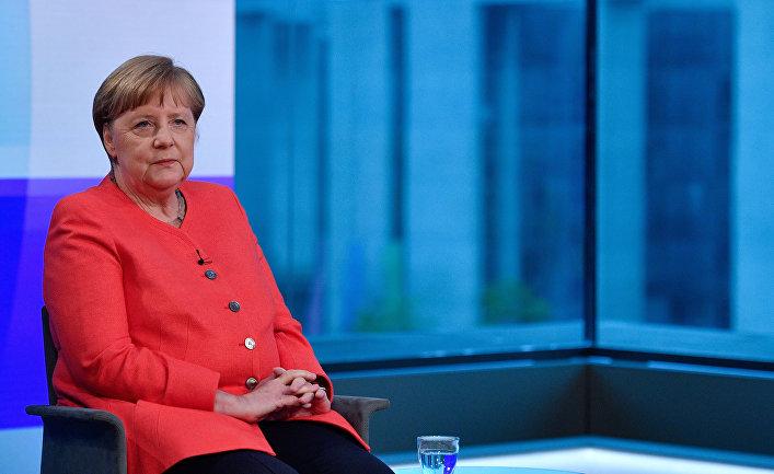 Ангела Меркель во время интервью на немецком телевидении