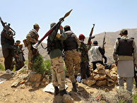 Вооруженные люди на контрольно-пропускном пункте в районе Горбанд