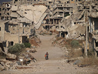 Руины зданий в городе Дараа, Сирия